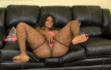Black webcam babe plays with pussy