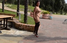 Mature lady in black stockings showing off her fat body in public