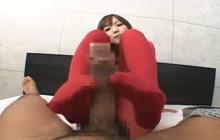 Asian girl in pantyhose gives footjob