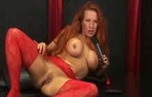 Faye Rampton in pantyhose playing with her toys