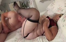 Obese woman in black stockings gets oral pleasure before sex