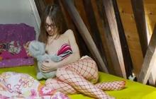 Young Brunette Teasing In Fishnet