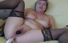 Mature in stockings toying pussy and ass